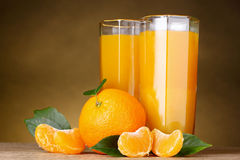 Glasses of healthy fresh juice  on brown Royalty Free Stock Photos