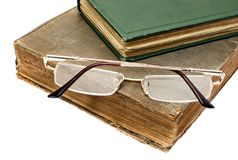 Glasses on the heap old books Stock Photos