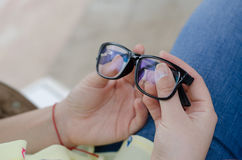 Glasses hold in hand at park Stock Image