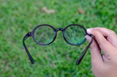 Glasses. Holding glasses by hand royalty free stock image