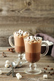 Glasses of hot chocolate with marshmallows on grey wooden backgr Stock Photography