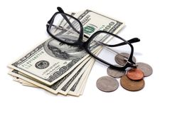 Glasses, hundreds and coins over white. Stock Photography