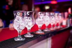 Glasses with ice on the bar counter Stock Image