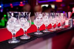 Glasses with ice on the bar counter Stock Photography