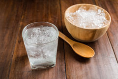 Glasses with ice cubes on wooden background Royalty Free Stock Photography