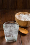 Glasses with ice cubes on wooden background Stock Image