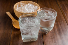Glasses with ice cubes on wooden background Royalty Free Stock Photos