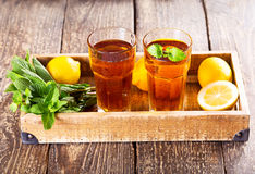 Glasses of ice tea with mint and lemon Royalty Free Stock Images