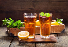 Glasses of ice tea with mint and lemon Stock Photo