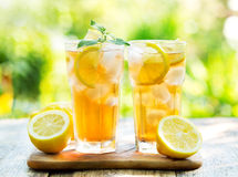 Glasses of ice tea with mint and lemon Stock Image