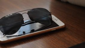 Glasses iphone table creative study.  stock footage
