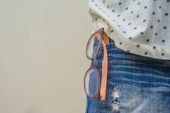 Glasses and jeans Stock Image