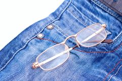 Glasses in jeans pocket Stock Photos