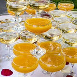 Glasses with juice and champagne Stock Photography