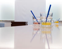 Glasses of juice in conference room stock photos