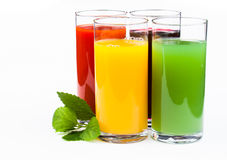 Glasses of juice  isolated on white Royalty Free Stock Images