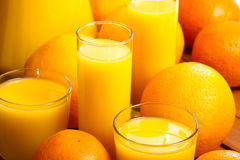 Glasses of  juice  and oranges Royalty Free Stock Photography
