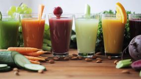 Glasses of juice, vegetables and fruits on table stock video
