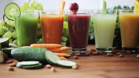 Glasses of juice, vegetables and fruits on table stock video footage