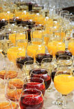 Glasses of juice and wine at the banquet Royalty Free Stock Photos