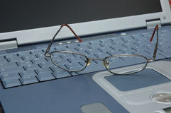 Glasses on keyboard. Glasses lying on laptops keyboard Stock Image