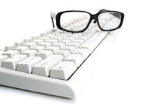 Glasses on the keyboard Stock Images