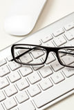 Glasses and keyboard Stock Image