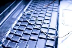 Glasses on Keyboard Stock Image