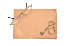 Glasses and keys on brown paper. Stock Photo