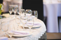 Glasses and Lace Tablecloth Stock Photo