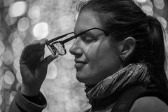 Eye Glasses. Lady taking her eye glasses off Stock Image