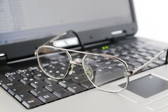 Glasses and laptop Royalty Free Stock Photography
