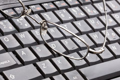 Glasses and laptop Royalty Free Stock Image