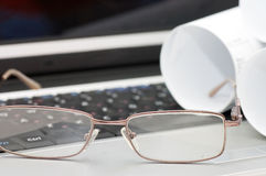 Glasses on the laptop Royalty Free Stock Photos