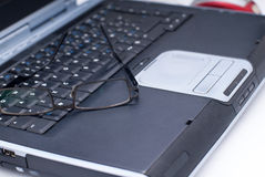 Glasses on laptop. Business laptop with glasses on it Stock Images