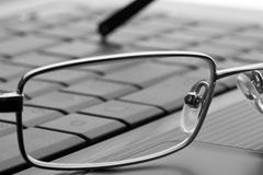 Glasses on laptop Stock Photo