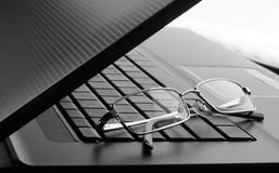 Glasses on laptop stock photography