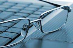 Glasses on laptop Stock Image