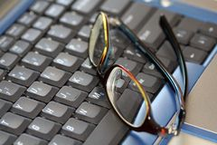 Glasses on a laptop Stock Photo