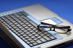 Glasses on laptop royalty free stock photo