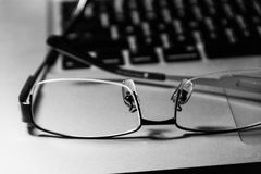 Glasses on laptop Royalty Free Stock Images
