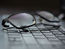 Glasses on a laptop stock photography
