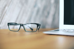Glasses and laptop closeup Stock Photography