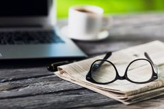 Glasses and laptop. Break broadsheet business coffee communication computer Stock Images