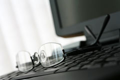 Glasses on Laptop Keyboard Stock Image
