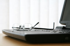 Glasses on Laptop Keyboard Royalty Free Stock Photography