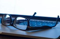 Glasses on  laptop keyboard Stock Photography