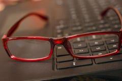 Glasses on laptop keyboard Stock Image