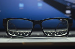 Glasses on laptop keyboard Royalty Free Stock Image