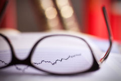 Glasses are laying on ashare index Stock Photos